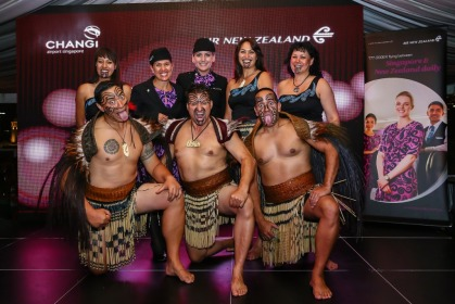 Air New Zealand staff in Maori outfits greet guests with a traditional Kapa Haka performance